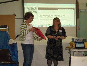 Suzanne receives herbarium from Joy
